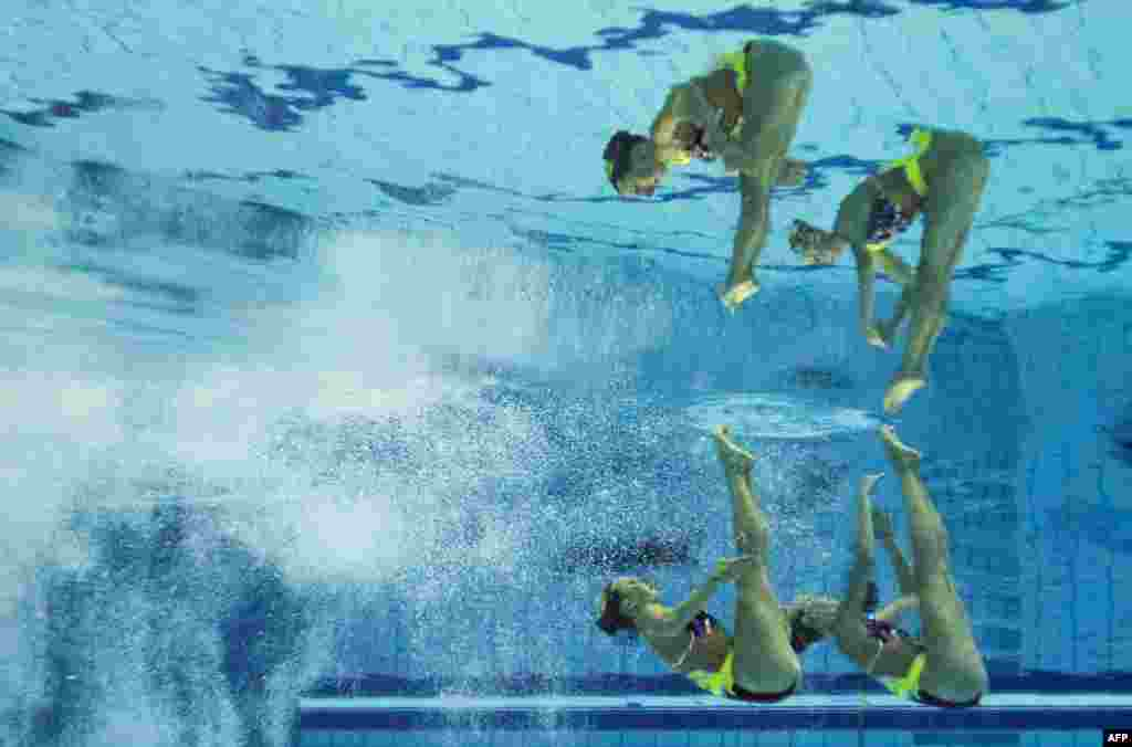 This picture taken with an underwater camera shows the German team competing in the synchronised swimming duet free preliminary event at the 32nd LEN European Swimming Championships in Berlin.
