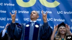 """President Barack Obama and student Jacqueline Rodriguez flash the symbol of the school mascot """"Anteaters"""" of the University of California, Irvine, in Anaheim, June 14, 2014."""