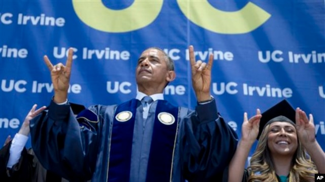 "President Barack Obama and student Jacqueline Rodriguez flash the symbol of the school mascot ""Anteaters"" of the University of California, Irvine, in Anaheim, June 14, 2014."