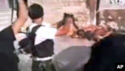 This image made from amateur video released by Tabshoor1 and accessed July 31, 2012, purports to show Free Syrian Army soldiers executing Assad loyalists in Aleppo, Syria. THE ASSOCIATED PRESS IS UNABLE TO INDEPENDENTLY VERIFY THE AUTHENTICITY, CONTENT,
