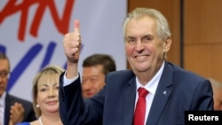 Czech President Milos Zeman reacts after his victory over pro-EU academic Jiri Drahos in the presidential election in Prague, Czech Republic, Jan. 27, 2018.