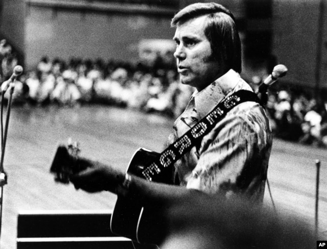 FILE - In this undated photo, Country singer George Jones is shown performing with his guitar.