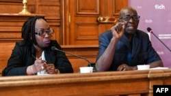President of the Association for the Protection of Human Rights and Detained Persons Pierre Claver (R) and Burundian journalist Elyse Ngabire (L) speak during a press conference organized by the International Federation for Human Rights (FIDH) about a May 17 referendum in Burundi, in Paris, May 15, 2018.