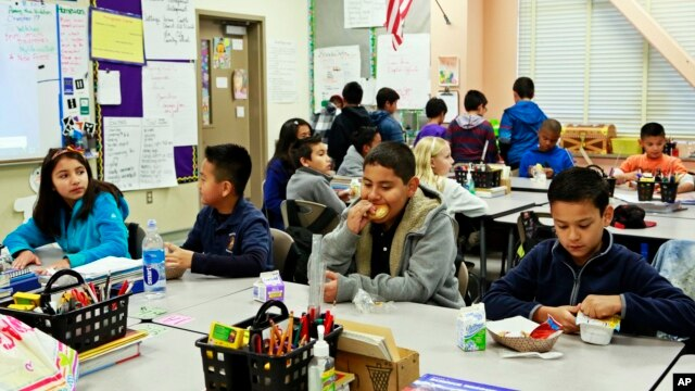 FILE - Students are served breakfast at the Stanley Mosk Elementary School in Los Angeles, California, April 8, 2015.