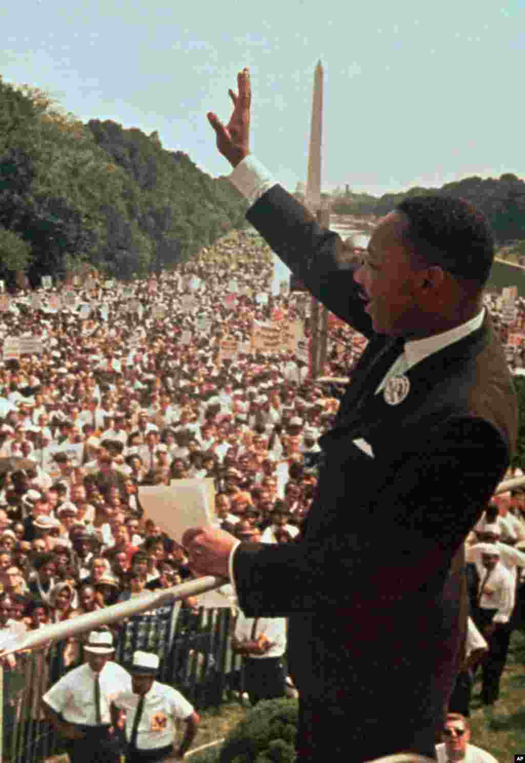 "Martin Luther King, Jr. acknowledges the crowd at the Lincoln Memorial for his ""I Have a Dream"" speech during the March on Washington, August 28, 1963."
