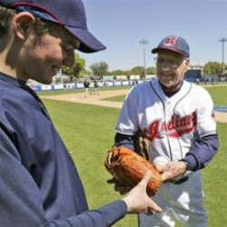 Major League Baseball Hall of Fame member Bob Feller with grandson Dan Feller.