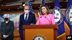 FILE - Speaker of the House Nancy Pelosi, D-Calif., center, joined from left by Treasury Secretary Janet Yellen and Senate Majority Leader Chuck Schumer, D-N.Y., updates reporters on Democratic efforts at the Capitol, Sept. 23, 2021.