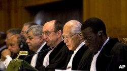 The court ruling is read out by presiding President Owada on whether it has the jurisdiction to hear Georgia's claim of Russian human rights abuses on its territory, in The Hague, April 1, 2011