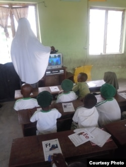 "Students watch ""Sesame Square"" with their teacher in a school in Ijebu-Lekki, Nigeria, February 2012. Naomi Moland, a lecturer at American University in Washington who studies the Nigerian version of ""Sesame Street,"" said the program producers tried to indirectly combat Boko Haram in northern Nigeria. (N. Moland)"