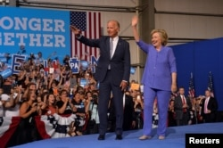 Democratic presidential candidate Hillary Clinton and Vice President Joe Biden campaign together during an event in Scranton, Pa., Aug. 15, 2016.