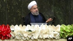 FILE - Iranian President Hassan Rouhani speaks during the inauguration of the new parliament, in Tehran, Iran, May 28, 2016.