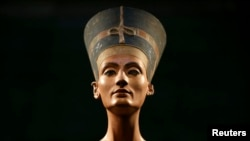 FILE - The Nefertiti bust is pictured during a press preview of the exhibition 'In The Light Of Amarna' at the Neues Museum in Berlin, Germany, due to the 100th anniversary of the discovery of the famous sculpture of the ancient Egyptian queen Nefertiti.