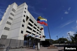 FILE - A man walks in front of a building of the Venezuela Supreme Court in Caracas, Dec. 23, 2015.