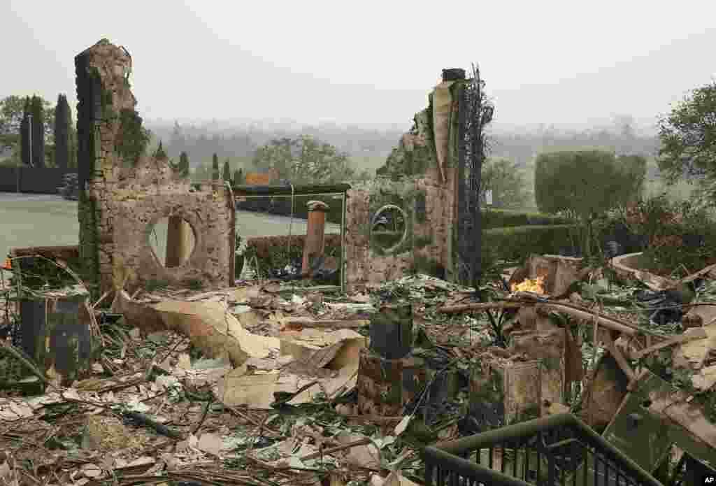 The remains of the Signorello Estate winery continue to smolder, Oct. 10, 2017, in Napa, California.