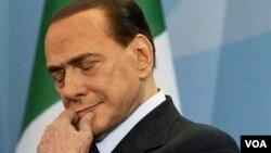 PM Italia Silvio Berlusconi, pemimpin Barat pertama yang secara terbuka menentang misi NATO di Libya (7/7).