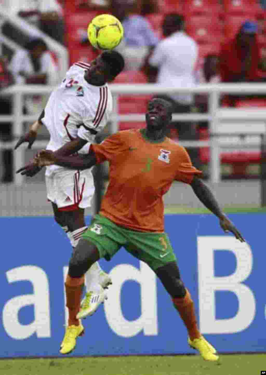 "Chisamba Lungu of Zambia (R) fights for the ball with Khalefa Ahmed of Sudan during their African Nations Cup quarter-final soccer match at Estadio de Bata ""Bata Stadium"", in Bata February 4, 2012."
