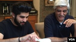 Danish Bashir eats dinner with his father, Imran, at their home in Springfield, Virginia. (C. Presutti/VOA)