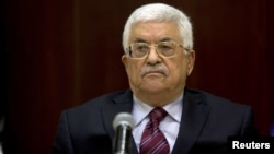 FILE - Palestinian President Mahmoud Abbas chairs a Palestinian Liberation Organization (PLO) executive committee meeting in the West Bank city of Ramallah, Aug. 22, 2015.