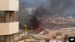 Image from video posted by Libyan blogger shows Corinthia Hotel under attack, Tripoli, Libya, Jan. 27, 2015.