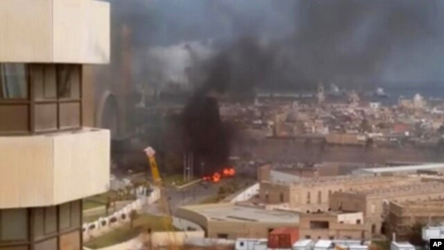 FILE - In this image made from video, the Corinthia Hotel is seen under attack in Tripoli, Libya, Jan. 27, 2015.