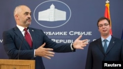 FILE - Albanian Prime Minister Edi Rama, left, and his Serbian counterpart Aleksandar Vucic attend a news conference after their meeting in Belgrade, Serbia, Nov. 10, 2014.
