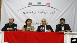 From left, Ahmed Ramadan, Bassma Kodmani, Abdulbaset Seida and Imad Aldeen Rashid speak as a group of Syrian opposition members announced a Syrian National Council in Istanbul, Turkey (File Photo - September 15, 2011).