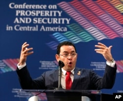 The President of Guatemala Jimmy Morales speaks during a conference on Prosperity and Security in Central America, June 15, 2017, in Miami.