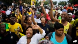 Members of the African National Congress (ANC) and mourners sing to celebrate the life of Nelson Mandela outside his old house in Soweto, Johannesburg, South Africa, Dec. 8. 2013.
