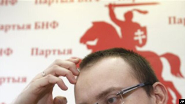 Ales Mikhalevich, a candidate in Belarus' recent presidential election, speaks during a news conference in Minsk, Belarus, Monday, Feb. 28, 2011, where he said he was tortured in prison.