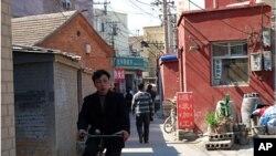 Man rides through the heart of Caochangdi Village