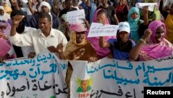 FILE - Mauritanian anti-slavery protesters march to demand the liberation of imprisoned abolitionist leader Biram Ould Abeid in Nouakchott, May 26, 2012.