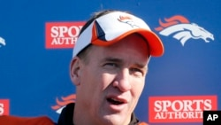 Denver Broncos quarterback Peyton Manning talks to the media Jan. 23, 2014.