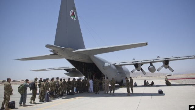 FILE - Afghan National Army soldiers line up to get into a C-130 Hercules at Kandahar Air Base in Kandahar, Afghanistan, Aug. 18, 2015. A newly formed battalion will be made up largely of former Afghan soldiers, the Afghan government announced.
