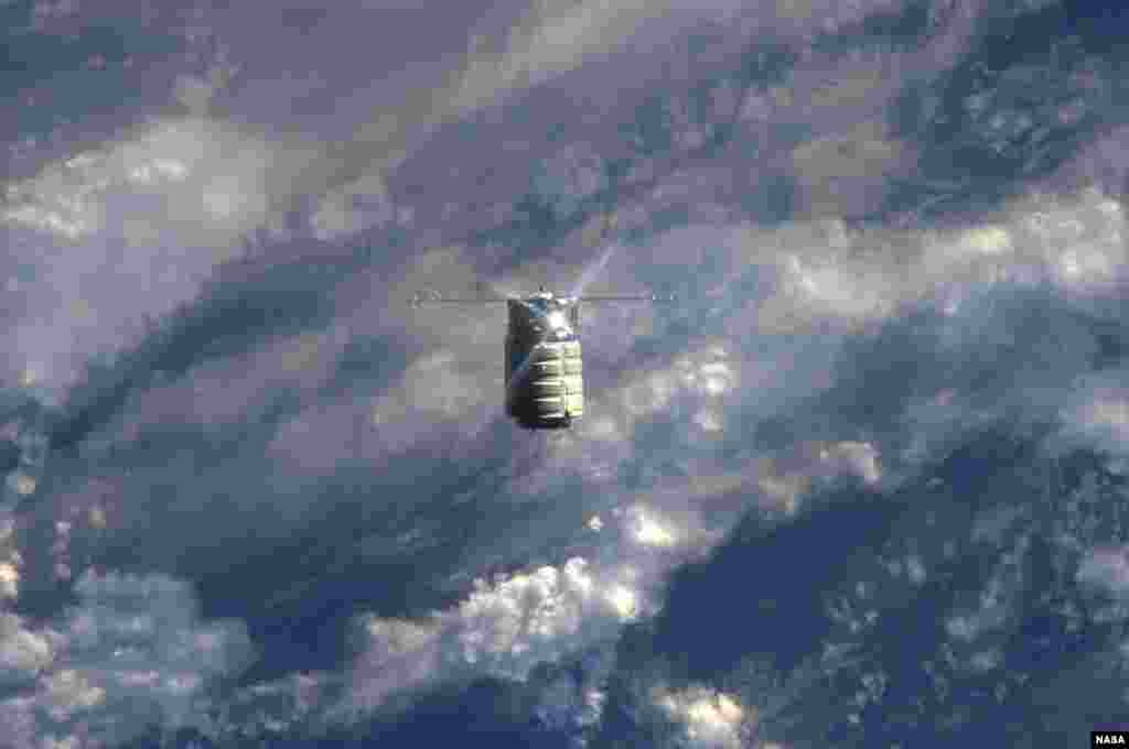 The unmanned U.S. commercial cargo ship Cygnus is seen approaching the International Space Station, Sept. 29, 2013.