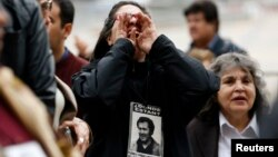 Human rights activists shout slogans at a memorial for Chile's deceased former president, Salvador Allende, whose democratically elected government was toppled in 1973 by General Augusto Pinochet, in Santiago, September 4, 2013.