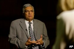 Sri Lankan Prime Minister Ranil Wickremesinghe takes a question during an interview with the Associated Press at his office in Colombo, Sri Lanka, April 25, 2019.