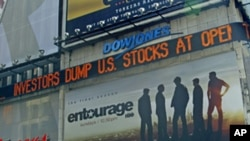A Dow Jones news ticker in Times Square, NY, carries headlines including reaction to U.S. economy, Aug. 8, 2011