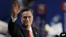 Mitt Romney waves to delegates before speaking at the Republican National Convention