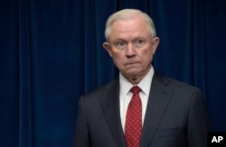 FILE - Attorney General Jeff Sessions waits to make a statement at the U.S. Customs and Border Protection office in Washington, March 6, 2017.