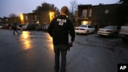 FILE - A U.S. Immigration and Customs Enforcement agent.