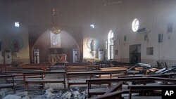 The damaged interior of the Holy Family Syrian Catholic Church after an early morning car bomb attack in Kirkuk, 290 kilometers (180 miles) north of Baghdad, August 2, 2011
