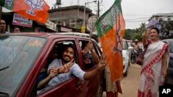 Bharatiya Janata Party (BJP) supporters celebrate their party's win in state assembly elections in Gauhati, Assam state, India, May 19, 2016. India's ruling Hindu nationalist party made dramatic gains in elections in the eastern state.