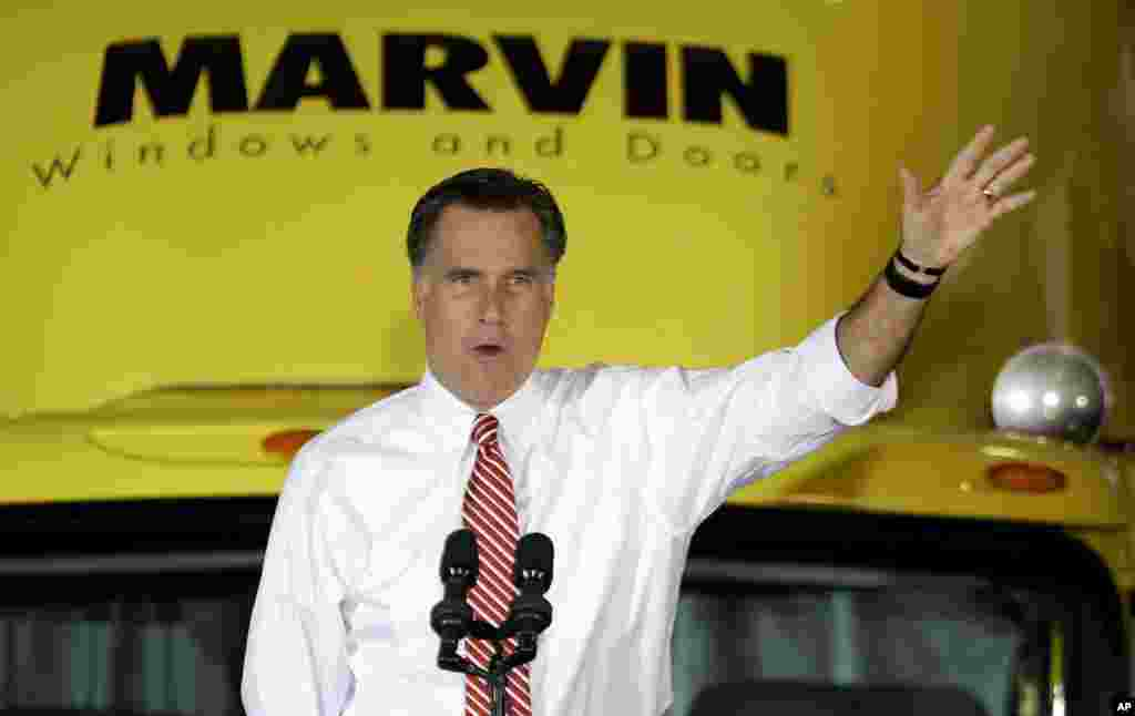 Republican presidential candidate, former Massachusetts Gov. Mitt Romney gestures as he speaks at a campaign event at Integrity Windows in Roanoke, Va., November 1, 2012.