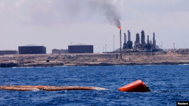 FILE - A general view of the port and Zawiya Oil Refinery, west of the city of Tripoli. Libya.