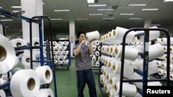 An employee works inside a textile mill in Yiwu, Zhejiang province.