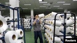 An employee works inside a textile mill in Yiwu, Zhejiang province.
