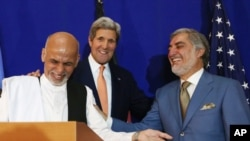 Afghan presidential candidate Abdullah Abdullah, from right, U.S. Secretary of State John Kerry and Afghan presidential candidate Ashraf Ghani Ahmadzai share a light moment at the podium during a joint press conference in Kabul, Afghanistan, Aug. 8, 2014.
