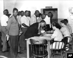 Black Americans register to vote as South Carolina Democrats in Charleston, S.C., July 17, 1948.