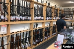 Firearms and accessories are displayed at Gun City gunshop in Christchurch, New Zealand, March 19, 2019.