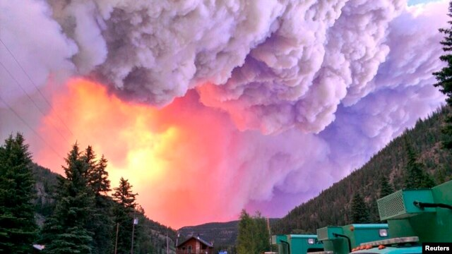 U.S. Forest Service photo shows fire rising over the West Fork Complex in Colorado, June 20, 2013.